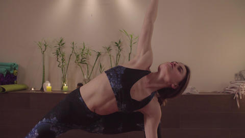Young flexible woman practicing yoga indoors Stock Video Footage
