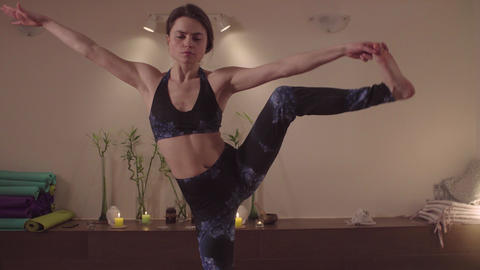 Flexible woman doing yoga asanas in nice studio Live Action