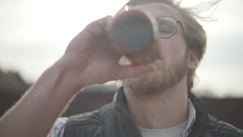 Close up portrait bearded man with glasses drinking beer and enjoying beverage Live Action
