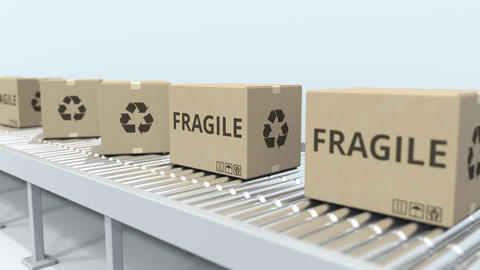 Boxes with FRAGILE text on roller conveyor. Loopable 3D animation Archivo