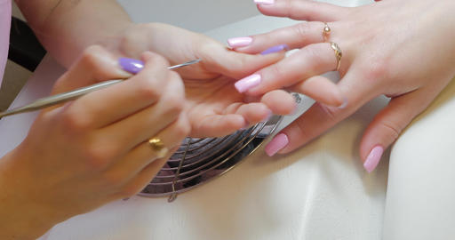 Manicure master makes corrections to pink color gel polish ライブ動画