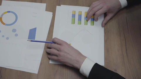 Shot of graphic data templates table with unrecognizable business people Footage