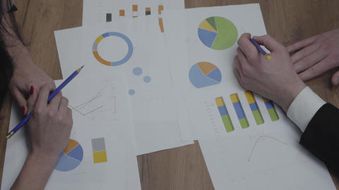 Shot of graphic data templates table with business people analyzing growth rates Footage