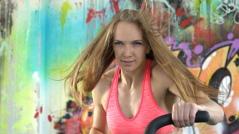 woman athlete doing intense workout on gym bike Footage
