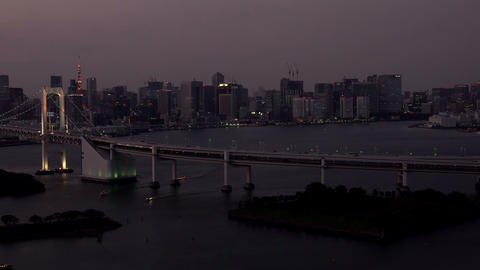 Tokyo skyline with Tokyo Tower and Rainbow Bridge after sunset in Tokyo, Japan Footage