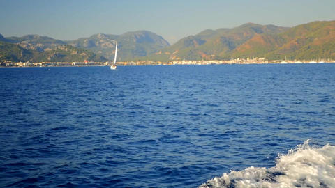 Luxury beautiful yacht in blue sea on mountain background, Mediterranean sea Footage