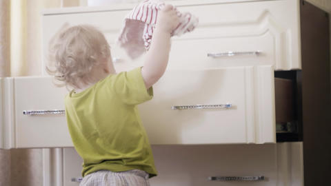 Little baby girl picks her clothes out of the dresser Footage