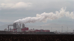 Image of a factory on the outskirts above which rises a huge cloud of water vapo Footage