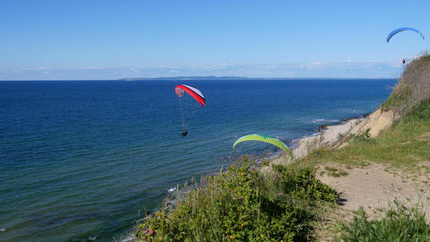 Paragliders Enjoying The Good Wind Along The Coast stock footage