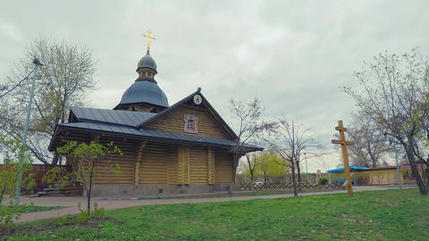 4K Hyperlaps. The wooden church in the old Russian style with a golden cross in Footage