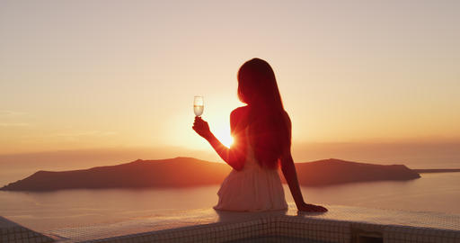 Woman at sunset luxury lifestyle - Woman drinking champagne Footage