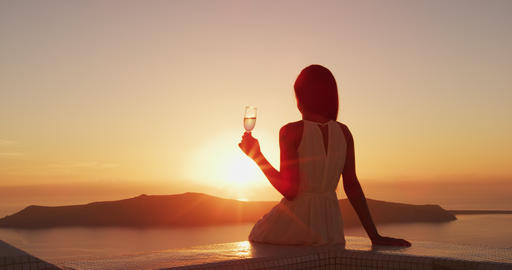 Luxury lifestyle - Woman drinking champagne at sunset Footage