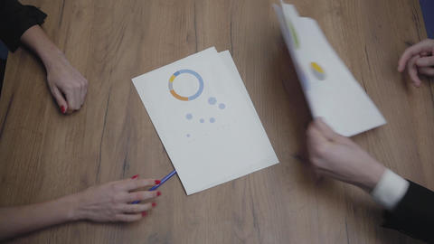 Top view shot of graphic data templates table with unrecognizable business Footage