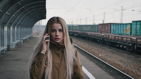 Blonde girl talking on the phone Footage