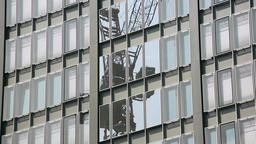 Office Windows Reflecting Construction Crane Live Action