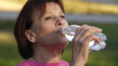 Woman drinking water Footage