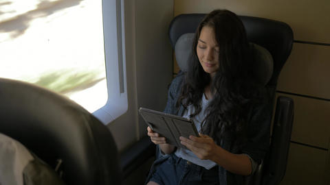 Woman With Tablet in Train Archivo