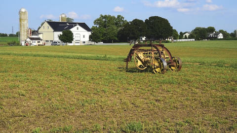 Old Amish Farm Equipment Seating in the Field Footage