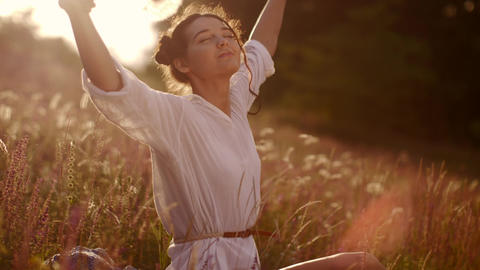 Beautiful carefree woman in fields being happy outdoors Live Action