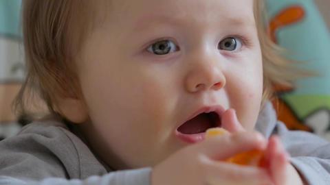 Little girl eating a Mandarin 006 Footage