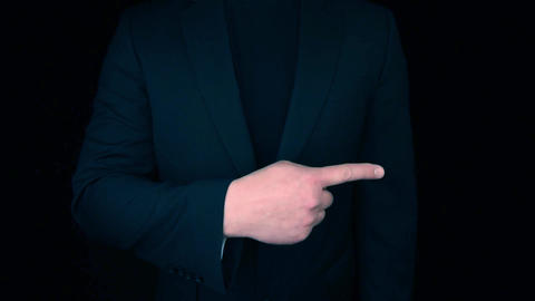 Business Man pointing with finger to the side to empty placeholder Live Action