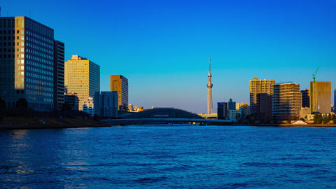 Sunset timelapse day to night at Sumida river in Tokyo tilt Footage