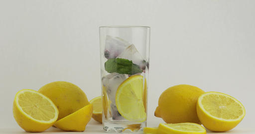 Pour a cold soda drink. Lemon and ice in a drink glass. Refreshing cocktail Footage