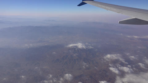 View from airplane flying over mountains Footage