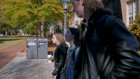 Two young female university students and a tall male... Stock Video Footage