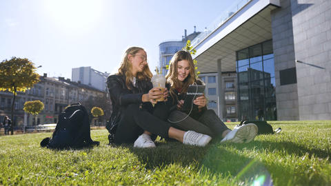 Friendship, people and technology concept - happy teenage friends using tablet Live Action