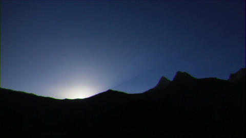 Glitch effect. Sun rises from behind the mountains. TimeLapse. Pamir, Tajikistan Live Action