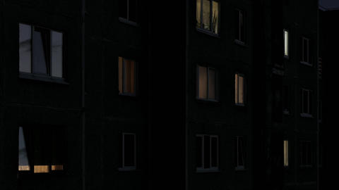 1080p Time Lapse of Windows of Multistory Apartment House After Sunset Footage