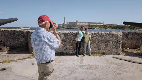 10-Senior Tourist Taking Souvenir Photo Family Vacations Cuba Steadicam Footage