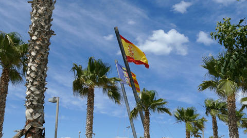 Spanish and Valencia city flag at cloudy sky Live Action