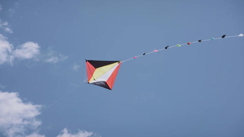 16-Colorful Kite Flying In The Blue Sky Slowmotion Footage