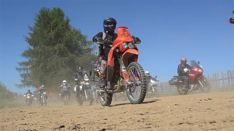 Group of bikers who hit the road leaving clouds of dust in their wake 16 Footage