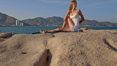 Blond Girl in Top in Yoga Pose Hands behind Back Footage