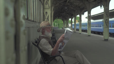 Old Man Reading Latest News Footage