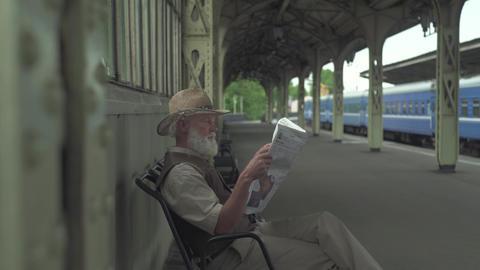 Old Man Reading Latest News Footage