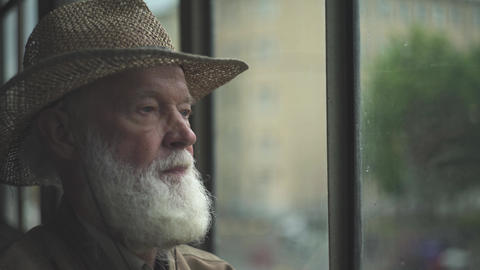 Elderly Man Looking Out Window Live Action