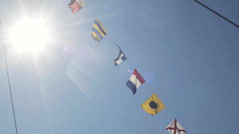 Nautical Flags Against Blue Sky Footage