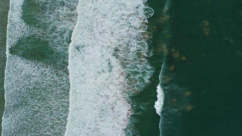 Aerial top view on ocean waves on Portugal coast Live Action