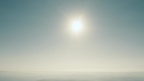 High altitude aerial view of the sun and clear blue sky Footage