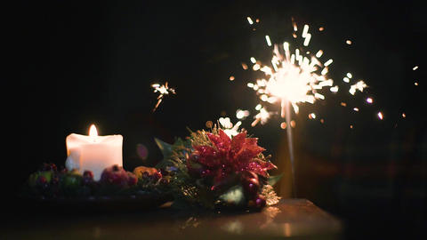 Christmas yellow candle, bengal fire and decoration on a dark background Footage
