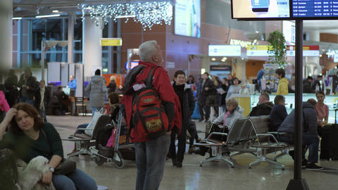 People in waiting area of Terminal D in Sheremetyevo Airport, Moscow GIF
