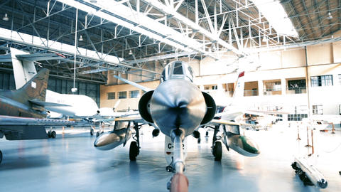 Fighter Plane Inside A Military Hangar Awaiting Deployment GIF
