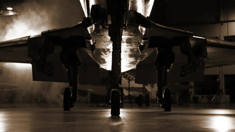 Combat Aircraft In A Hangar. Sepia Tone. Pan Shot Live Action