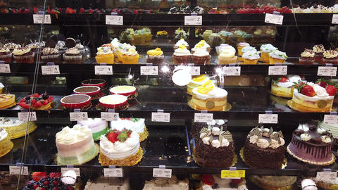 A Patisserie Shop Display With A Selection Of Cakes At Whole Foods Market GIF