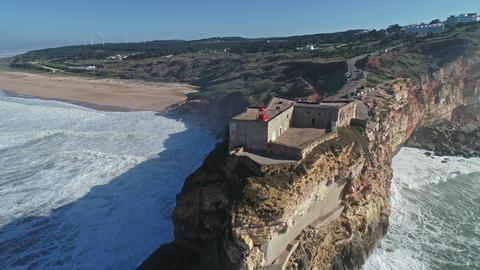 Lighthouse on cliff on Atlantic ocean in Nazare Footage