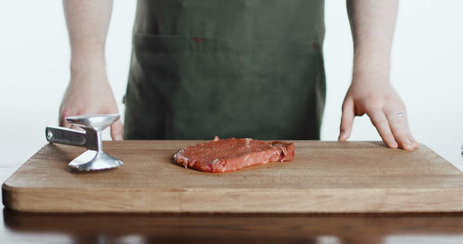 The cook beats meat on a cutting board Footage